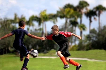 Fighting for soccer ball  Archivio Fotografico