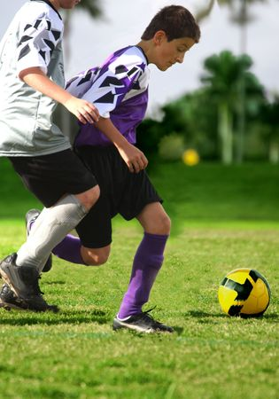 Fighting for soccer ball Stock Photo