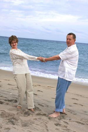 Romantic mature couple at the beach photo