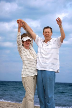Romantic mature couple having fun at the beach photo