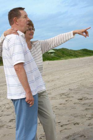 Romantic mature couple enjoing outdoor photo