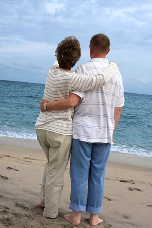 Romantic mature couple  walking at the beach  photo
