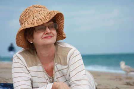Mature woman enjoing outdoor, beach photo
