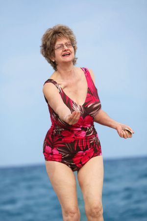 Mature woman relaxing at the  beach
