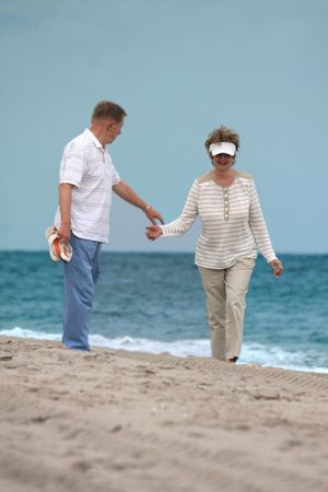Happy retired couple holding hands  photo