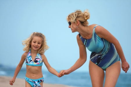 wade: Mother and daughter on the beach