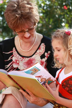 Grandma and grandaughter reading the book photo