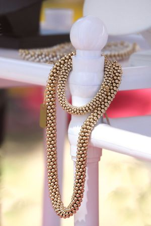 Luxury  golden fashion necklace on display Imagens
