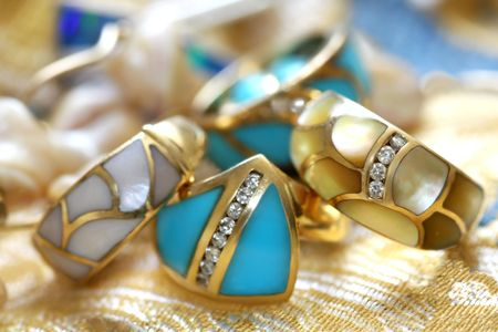 Turquoise and mother of perl rings accented with diamonds Stock Photo
