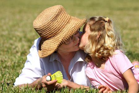 inocent: Granddaughters kiss Stock Photo