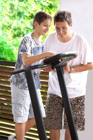 Father and son  training on a treadmill