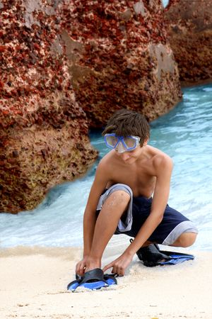 flippers: Boy wearing snorkeling goggles and  flippers Stock Photo