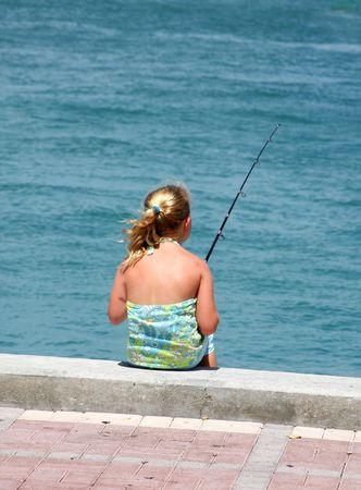 fishingline: Little girl fishing on Key West seafront