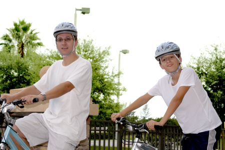 Father and son  on  the bikes riding in the city photo