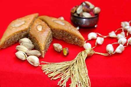 Ramadan scene-sweets , nuts and prayer beads Stock Photo