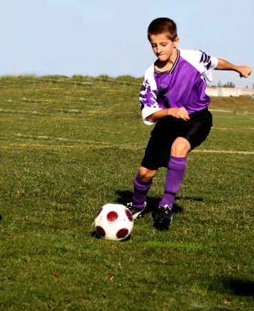 youth football: Soccer player in action Stock Photo