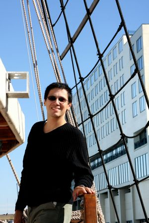 Handsome  man on boat with Savannah city building background
