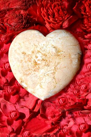 Heart on red petals photo