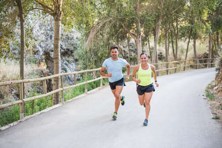 athlete couple running on the road