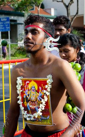 devotee: Serangoon, Singapore - January 30, 2010: Procession outside hindu temple on Serangoon road, Singapore