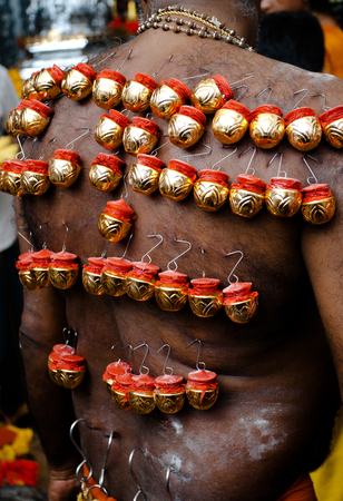 devotee: A devotee hook his back with bells in Thaipusam Stock Photo