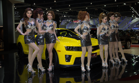 Bangkok, Thailand - March 28, 2014: Unidentified female presenters of Chevrolet car in Bangkok Motor Show 2014 Editorial