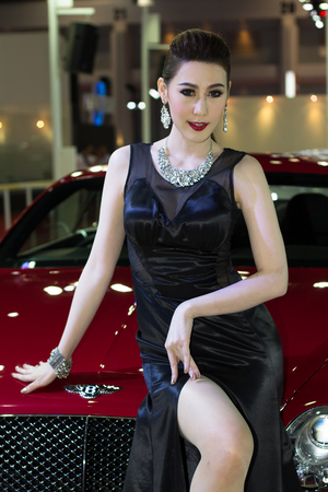 autoshow: Bangkok, Thailand - March 28, 2014: Unidentified female presenter of Bentley car in Bangkok Motor Show 2014 Editorial
