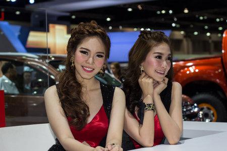 autoshow: Bangkok, Thailand - March 28, 2014: Unidentified female presenter in Bangkok Motor Show 2014
