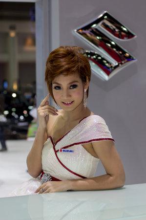 Bangkok, Thailand - March 29, 2013: Unidentified female presenter of Suzuki car in Bangkok Motor Show 2013