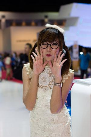 Bangkok, Thailand - March 29, 2013: Unidentified female presenter of Volkswagen in Bangkok Motor Show 2013