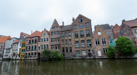Ghent, Belgium - June 26, 2011: View of belgian traditional house along the Ghent canal