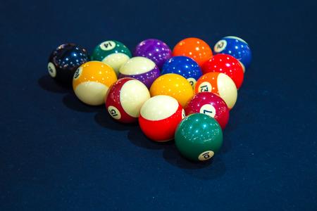 Billiard balls on billiard table Stock Photo