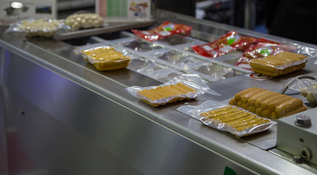 Packing of food sausage in production line