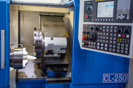 Bangkok, Thailand - November 21, 2018: CNC turning lathe machine display in Metalex 2018 Editorial