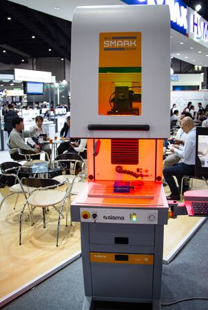 Bangkok, Thailand - November 21, 2018: 3D laser marking machine engraving on workpiece surface in Metalex 2018 Editorial