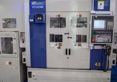 Bangkok, Thailand - November 21, 2018: Twin Spindle CNC Chucker machine display in Metalex 2018