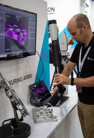 Bangkok, Thailand - November 21, 2018: Portable measuring arm scanner display in Metalex 2018