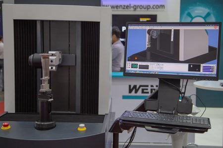 Bangkok, Thailand - November 21, 2018: 5-axis Coordinate Measuring Machine with analysis software measuring workpiece display in Metalex 2018 Editorial