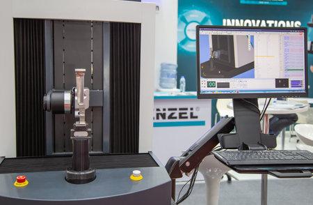 Bangkok, Thailand - November 23, 2018: 5-axis Coordinate Measuring Machine with analysis software measuring workpiece display in Metalex 2018 Editorial
