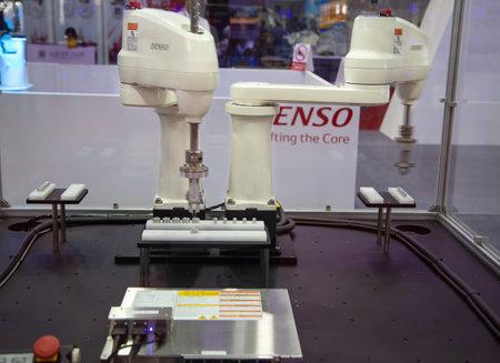 Bangkok, Thailand - November 23, 2018: Denso dual arm control loading  unloading automation robot in Metalex 2018