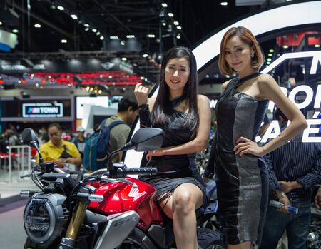 Nonthaburi, Thailand - December 4, 2018: Presenters pose with Honda motorcycle in Motor Expo 2018