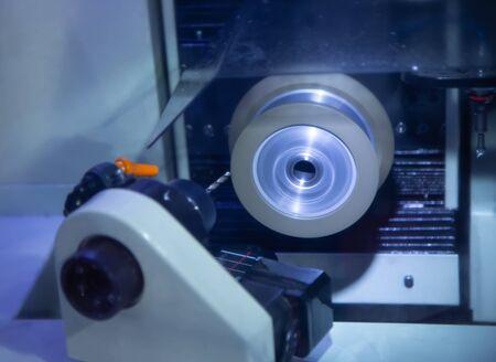 Carbide cutting tool sharpening on CNC machine Stok Fotoğraf - 128185369