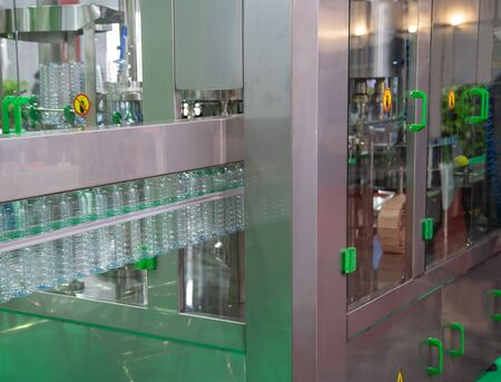 Production of water bottle filling and packing machine Stok Fotoğraf - 128185500