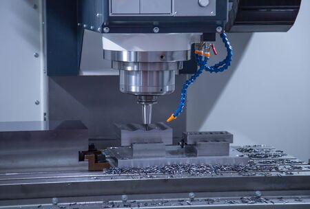 CNC milling machine cutting workpiece, industrial machining