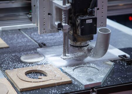 CNC Laser engraving machine carving alphabet on plastic plate Stok Fotoğraf - 128185703