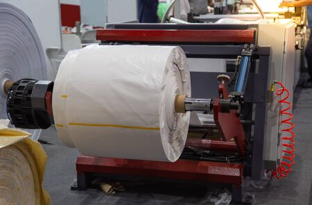 Roller of plastic sack on plastic woven machine