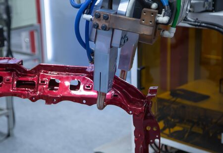 Automated robotic arm spot welding in automotive industry Stok Fotoğraf - 128186029