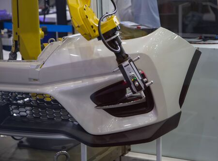 Automated robotic arm CMM scanning in automotive industry Фото со стока