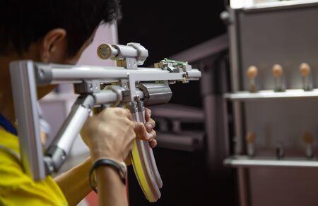 Man shooting aluminium light weight frame rubber gun