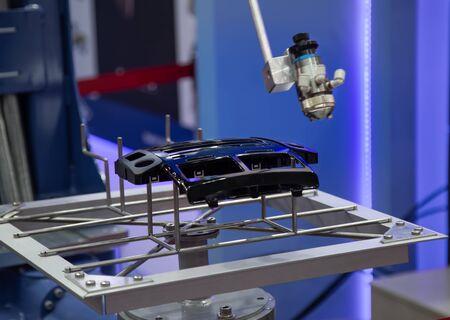 Robotic arm painting car part in automotive industry Stok Fotoğraf - 128186306